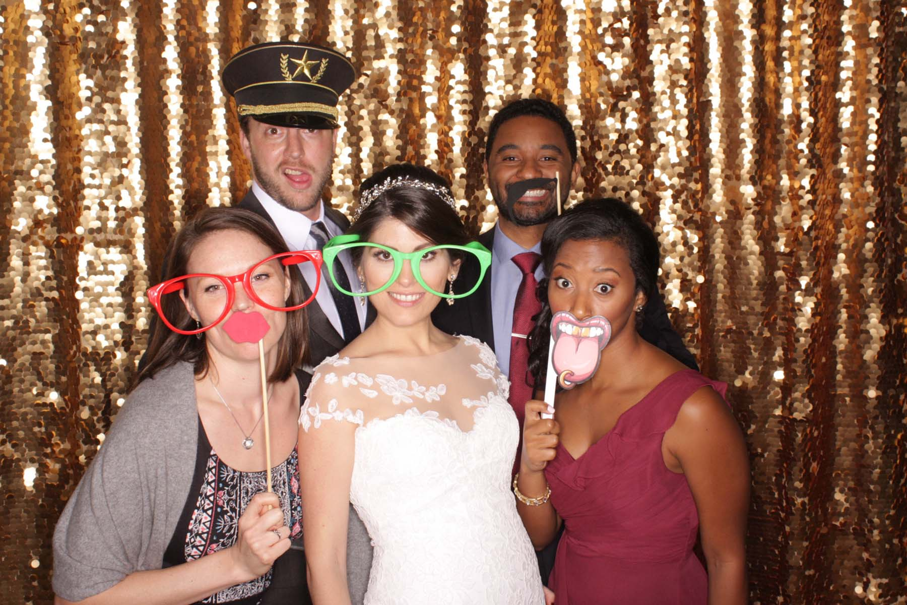 Bride with friends open air photo booth.