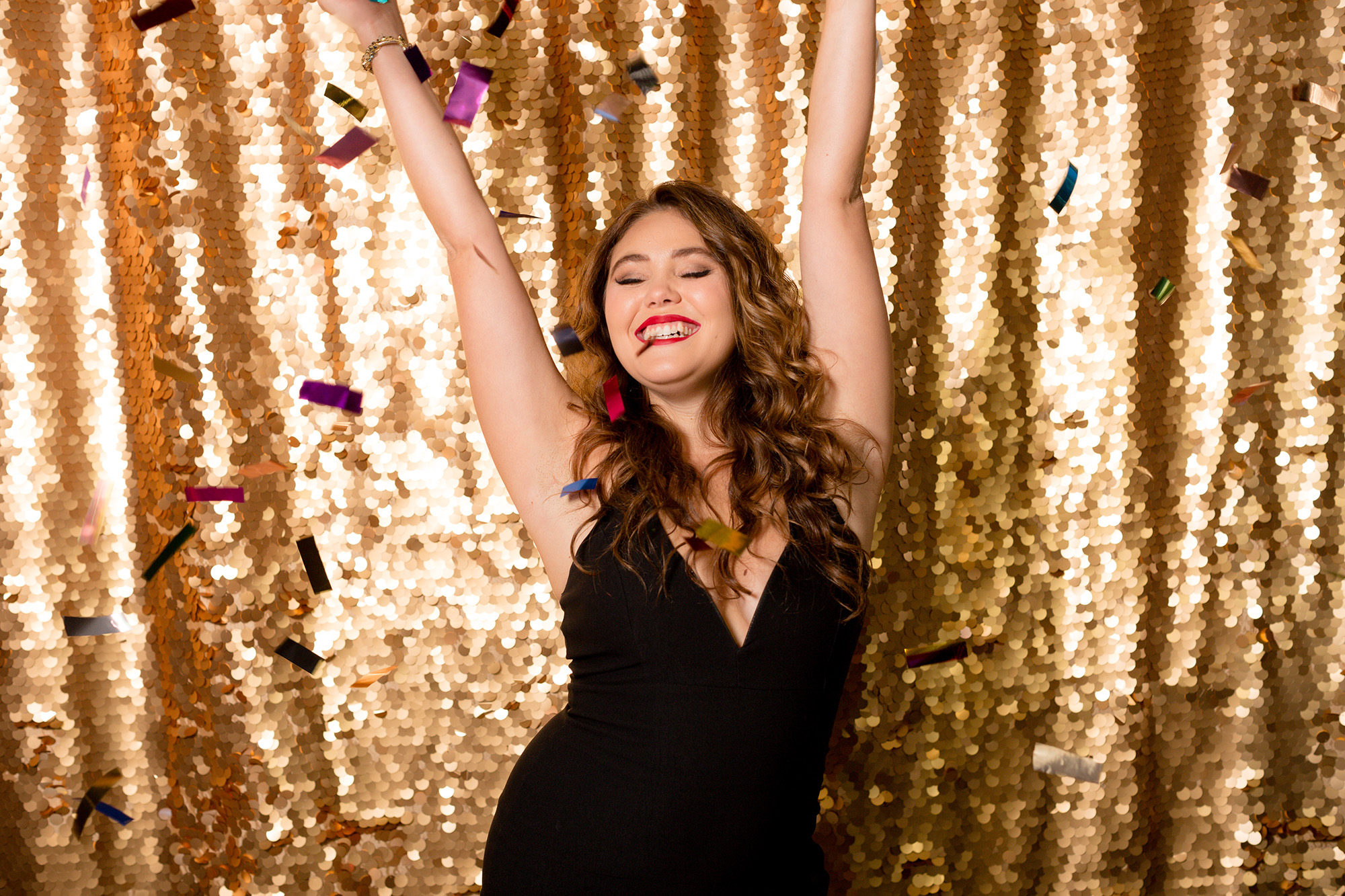 Gold Sequins Backdrop with confetti.